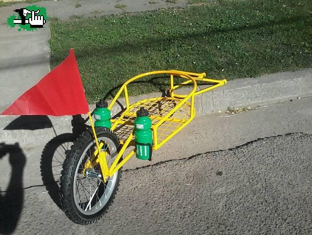 Como hacer un acople simple para un carrito para la bici foto for Como guardar bicis en un piso
